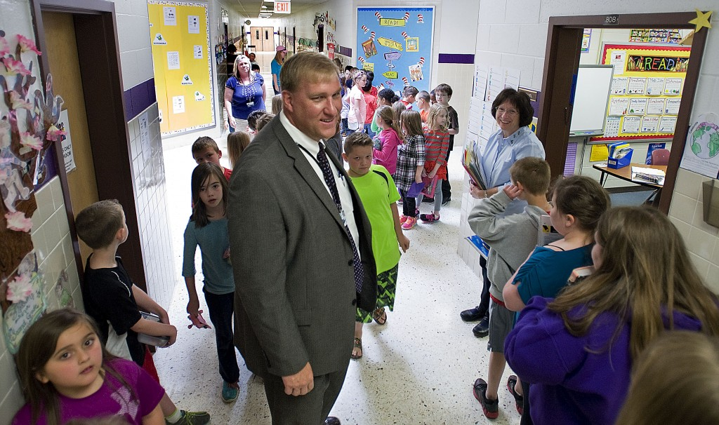Shenandoah County Schools Superintendent Jeremy Raley stands inside the hallway surrounded by students at Sandy Hook Elementary School during a school tour that was open for members of the School Board and Board of Supervisors on Friday.  Rich Cooley/Daily
